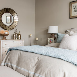 Example of a mid-sized transitional master medium tone wood floor and brown floor bedroom design in Denver with beige walls and no fireplace