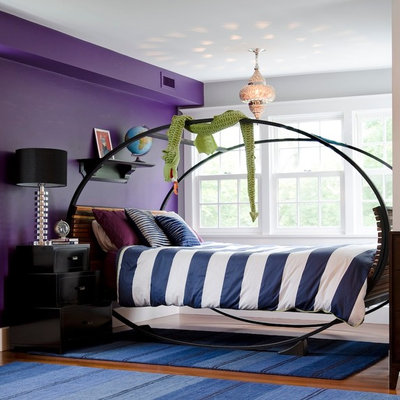 Example of a large eclectic dark wood floor bedroom design in Boston with purple walls and no fireplace