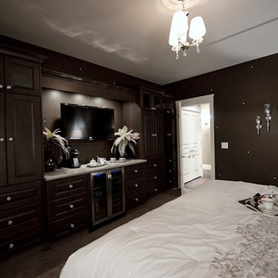 Large traditional master bedroom in Other with brown walls and carpet.