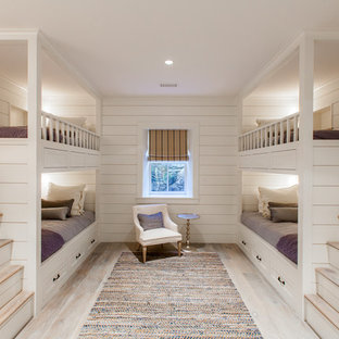Inspiration for a mid-sized coastal guest light wood floor bedroom remodel in Boston with white walls and no fireplace