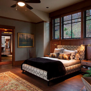 Photo of a large arts and crafts master bedroom in Other with grey walls, medium hardwood floors and brown floor.