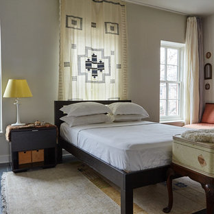 Inspiration for an eclectic guest black floor bedroom remodel in New York with gray walls and no fireplace