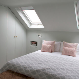 This is an example of a medium sized modern bedroom in London with beige floors and grey walls.