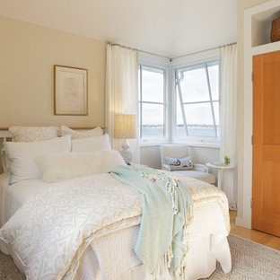 Bedroom - beach style light wood floor bedroom idea in Providence with beige walls and no fireplace