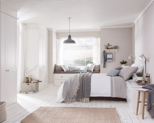 best design bedroom. Example of a large coastal guest light wood floor and white bedroom  design in West Best 30 Beach Style Bedroom Ideas Decoration Pictures Houzz