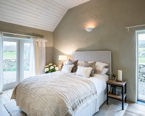 Photo Of A Beach Style Bedroom In Cheshire With Grey Walls, Light Hardwood  Flooring And