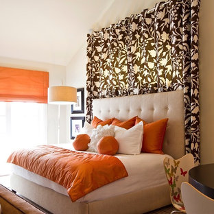 Contemporary bedroom in Orange County with beige walls.