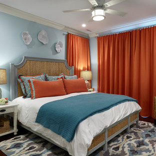 Inspiration for a beach style bedroom in Other with blue walls, dark hardwood floors and brown floor.