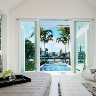Mid-sized trendy guest bedroom photo in Miami with white walls