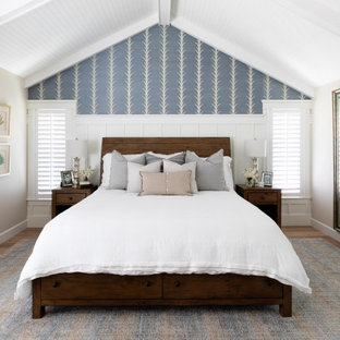 Example of a large transitional master medium tone wood floor, beige floor, wood ceiling and wainscoting bedroom design in San Diego with multicolored walls