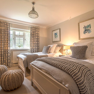 This is an example of a contemporary bedroom in Hampshire.