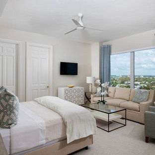 Large transitional guest carpeted and gray floor bedroom photo in Miami with beige walls
