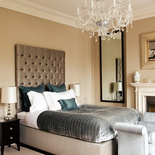 Charmant Ornate Master Carpeted Bedroom Photo In London With Beige Walls And A  Standard Fireplace