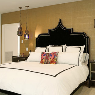 This is an example of a medium sized mediterranean master bedroom in Miami with beige walls, no fireplace, beige floors and porcelain flooring.