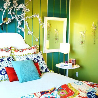 Inspiration for an eclectic bedroom in Boise with green walls.