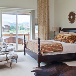 Inspiration for a rustic carpeted bedroom remodel in Denver with beige walls