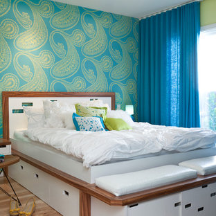 Example of a transitional light wood floor bedroom design in Other with multicolored walls