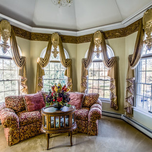 Design ideas for a large victorian master bedroom in New York with beige walls, carpet, no fireplace and brown floor.