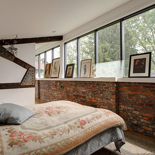 Photo of a loft-style bedroom in Columbus with white walls.
