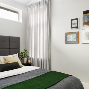 Example of a small danish guest carpeted and beige floor bedroom design in Seattle with gray walls