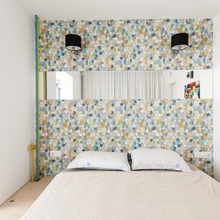 Small master plywood floor bedroom photo in Other with white walls