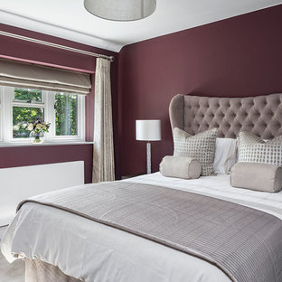 Photo of a medium sized traditional guest bedroom in Berkshire with purple walls, carpet and grey floors.
