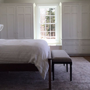 Bedroom - mid-sized country master dark wood floor bedroom idea in Burlington with white walls and a standard fireplace