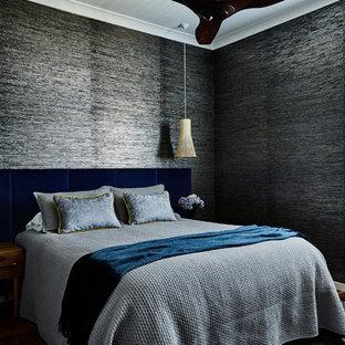Contemporary bedroom in Sydney with grey walls, medium hardwood floors and brown floor.