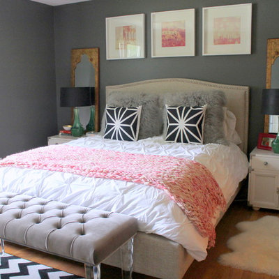 Bedroom - mid-sized eclectic master medium tone wood floor bedroom idea in Kansas City with gray walls