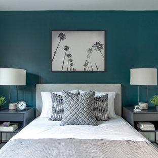 Imagen de habitación de invitados contemporánea, de tamaño medio, con paredes verdes y suelo gris