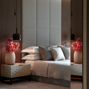 Contemporary master bedroom in London with carpet.