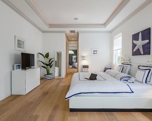 Example Of A Trendy Medium Tone Wood Floor And Brown Floor Bedroom Design  In Miami With