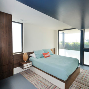 This is an example of a mid-sized contemporary guest bedroom in Philadelphia with white walls and carpet.