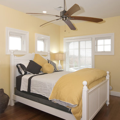Example of a trendy bedroom design in New York with yellow walls