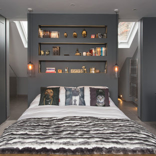 Contemporary master bedroom in London with grey walls and carpet.