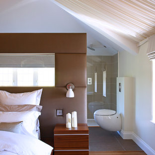 Inspiration for a large contemporary master bedroom remodel in London with white walls and no fireplace
