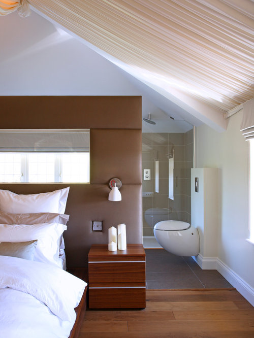 Inspiration For A Large Contemporary Master Bedroom Remodel In London With  White Walls