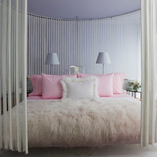 Inspiration for a contemporary bedroom in Los Angeles with purple walls.