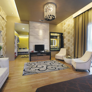 Inspiration for a contemporary medium tone wood floor bedroom remodel in Other with beige walls
