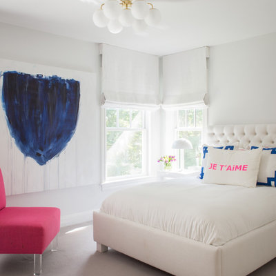Inspiration for a contemporary bedroom remodel in New York with white walls