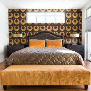 Design ideas for a contemporary bedroom in Sydney with black walls, medium hardwood floors and brown floor.