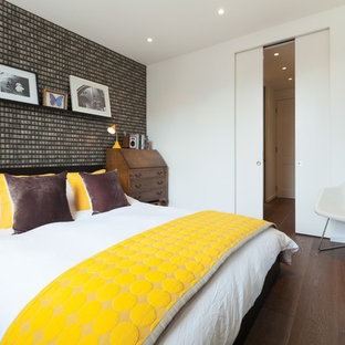 Inspiration for a contemporary bedroom in London with white walls and medium hardwood flooring.