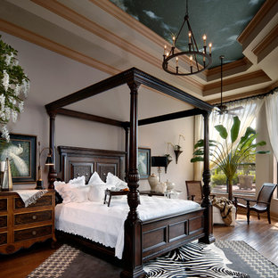 Example of a trendy master medium tone wood floor bedroom design in Miami with white walls