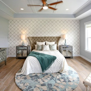 Example of a large transitional master medium tone wood floor and brown floor bedroom design in Salt Lake City with gray walls and no fireplace