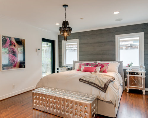 Example Of A Trendy Medium Tone Wood Floor Bedroom Design In Los Angeles  With White Walls Design Inspirations