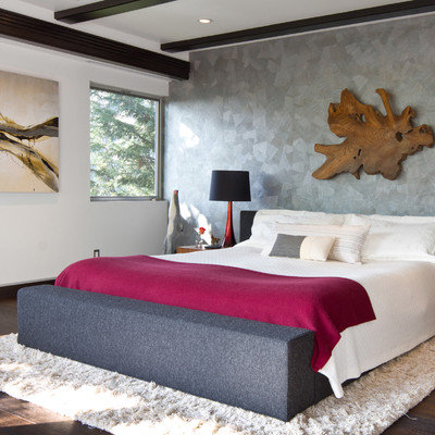 Inspiration for a large contemporary master dark wood floor and brown floor bedroom remodel in Los Angeles with gray walls and no fireplace