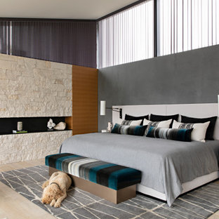 Bedroom - large contemporary master light wood floor and beige floor bedroom idea in Orange County with gray walls