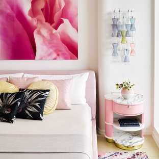 Inspiration for a contemporary bedroom in Miami with white walls, light hardwood floors and beige floor.