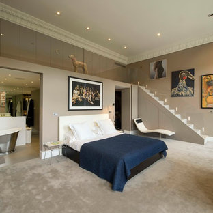 Photo of a large contemporary master bedroom in London with grey walls and carpet.