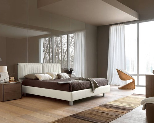 Contemporary bedroom idea in Other